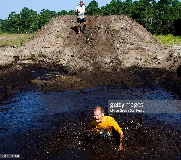 Mud is plentiful in the annual Dirty Myrtle Mud Run in the Waterbridge community of Carolina Forest South Carolina Saturday September 1 2012 In...