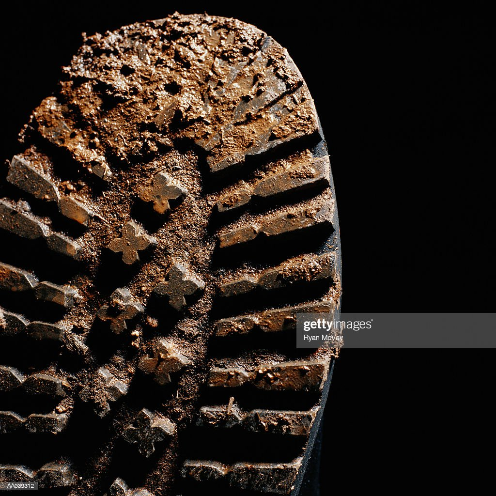 Mud on sole of boot, close-up