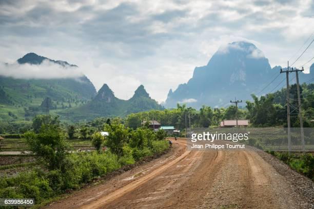 mud road to the the mountains near Luang Kasi, between Vang Vieng and Luang Prabang, Northern Laos, Southeast Asia