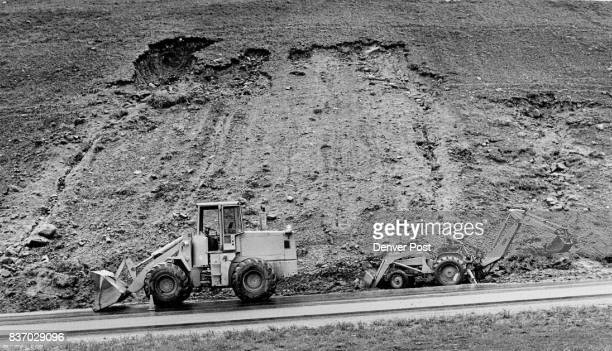 Mud slides on I70 on the West side of Vail Pass as highway heads down to Vail There are small slides all along the highway Here a loader clears on...