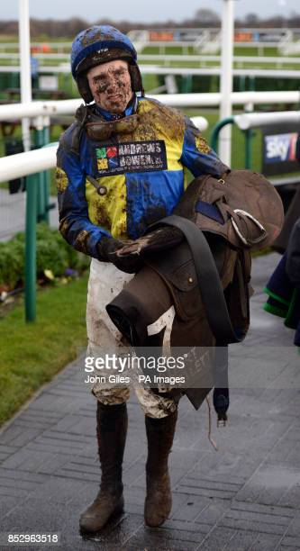 A mud splattered Harry Skelton returns to the weighing room after riding Walk On Al in the Albert Bartlett Novices Hurdle race during the SkyBet...