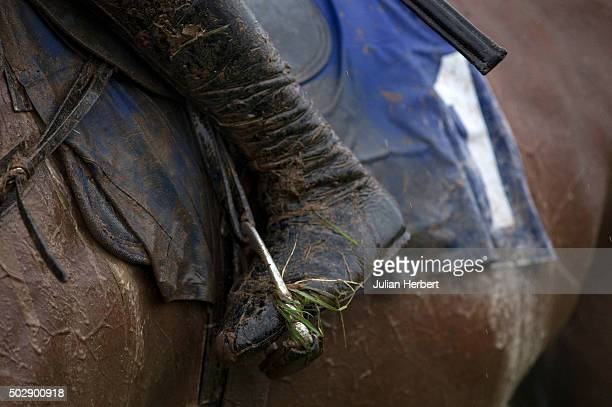A mud splattered jockey's boot as he returns after The Bet totequadpot Novices' Hurdle Race run at Taunton Racecourse on December 30 2015 in Taunton...