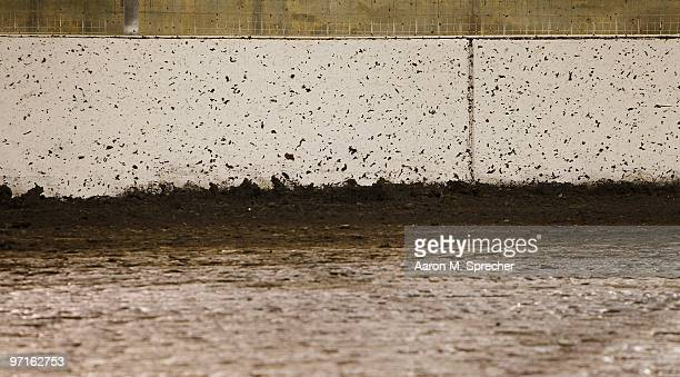 Mud splattered walls surround the track during the Texas World Dirt Track Modified Championship at the Texas World Dirt Track Championship at Texas...
