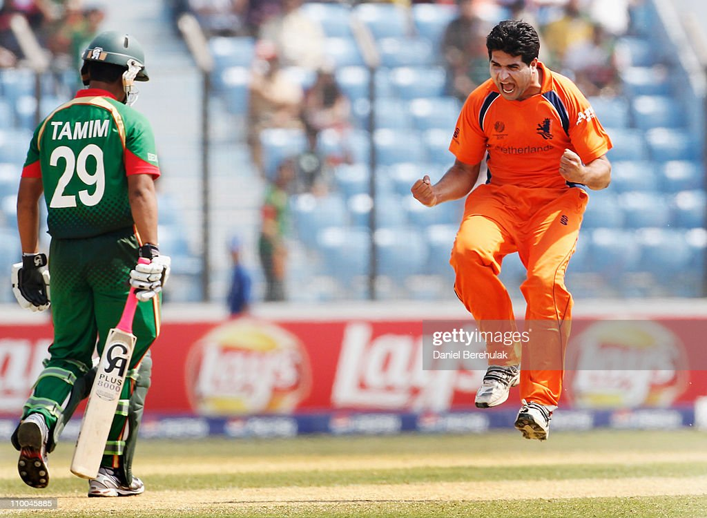 Mudassar Bukhari of the Netherlands celebrates after taking the wicket of <a gi-track='captionPersonalityLinkClicked' href=/galleries/search?phrase=Tamim+Iqbal&family=editorial&specificpeople=4181226 ng-click='$event.stopPropagation()'>Tamim Iqbal</a> of Bangladesh during the 2011 ICC Cricket World Cup group B match between Bangladesh and the Netherlands at Zohur Ahmed Chowdhury Stadium on March 14, 2011 in Chittagong, Bangladesh.