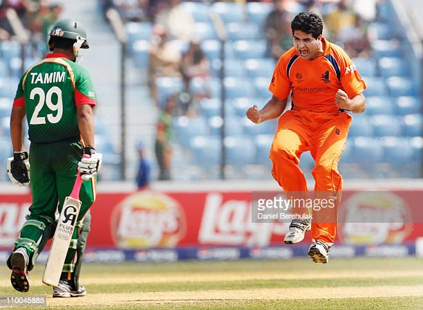 Mudassar Bukhari of the Netherlands celebrates after taking the wicket of Tamim Iqbal of Bangladesh during the 2011 ICC Cricket World Cup group B...