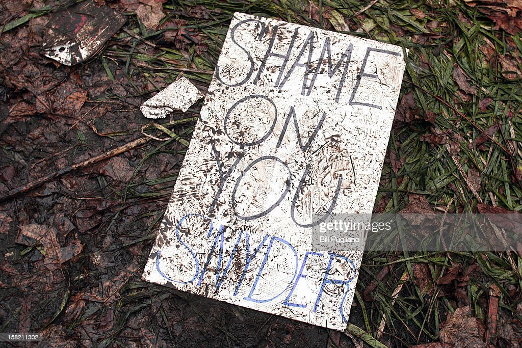 A muddied, trampled protestor's sign lies on the ground where union members from around the country rally at the Michigan State Capitol to protest a vote on Right-to-Work legislation December 11, 2012 in Lansing, Michigan. Republicans control the Michigan House of Representatives, and Michigan Gov. Rick Snyder has said he will sign the bill if it is passed. The new law would make requiring financial support of a union as a condition of employment illegal.