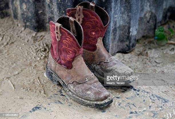 Muddy boots are common to see at FRIENDS a nonprofit horse rescue center that helps teach children discipline while caring for an unwanted brood in...