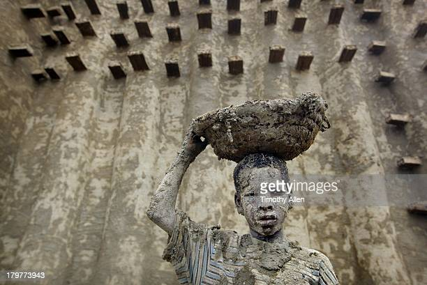 Muddy boy at The Great Mosque, Djenne