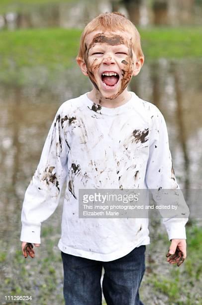Muddy boy yelling