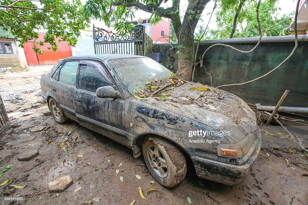 A muddy car is seen as the water level starts to decline in Wellampitiya, neighborhood of Colombo, Sri Lanka on May 25, 2016.