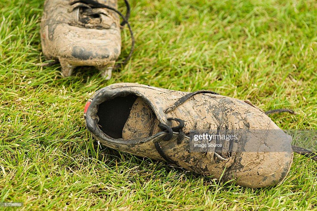 Muddy football boots : Stock Photo