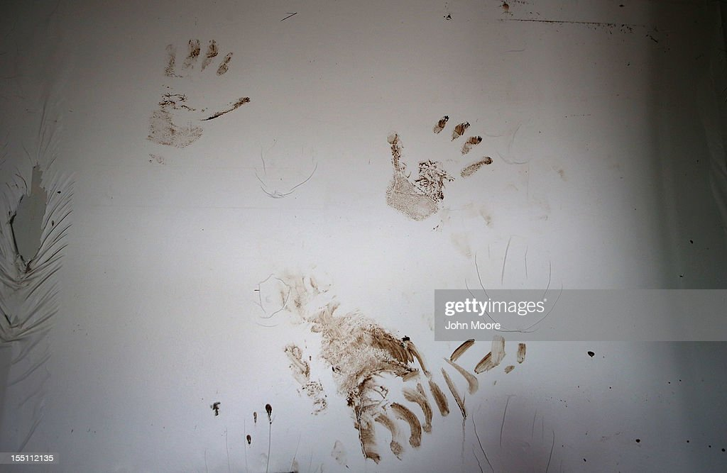 Muddy handprints mark the living room wall of homeowner Michael Russo on November 1, 2012 in the Ocean Breeze area of the Staten Island borough of New York City. The first floor of Russo's home was completely flooded by the ocean surge caused by superstorm Sandy.