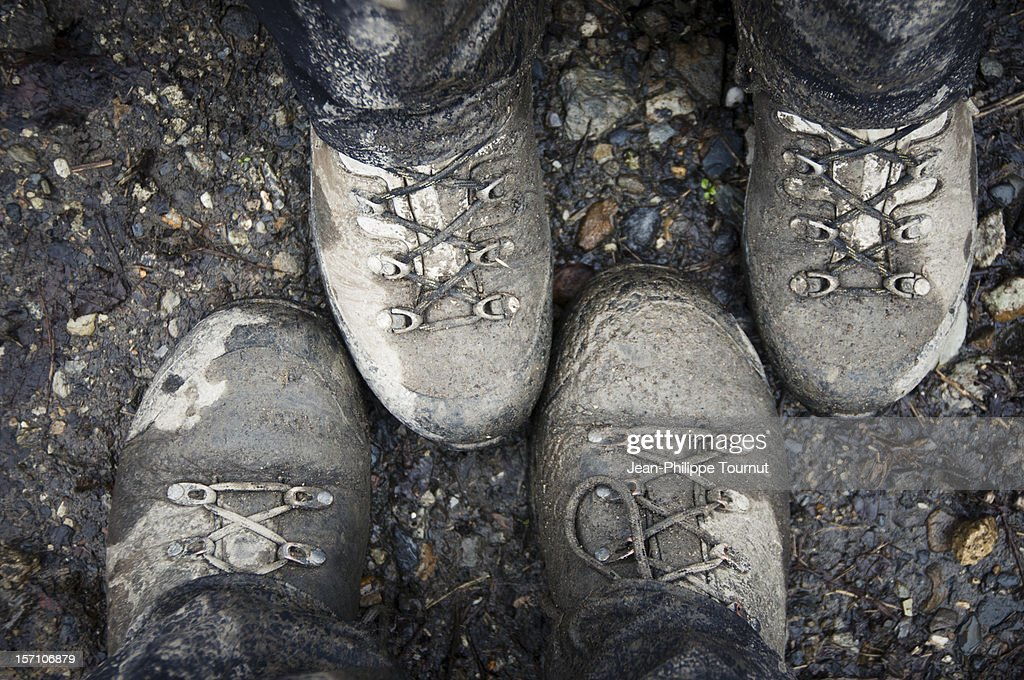 Muddy hiking shoes : Stock Photo