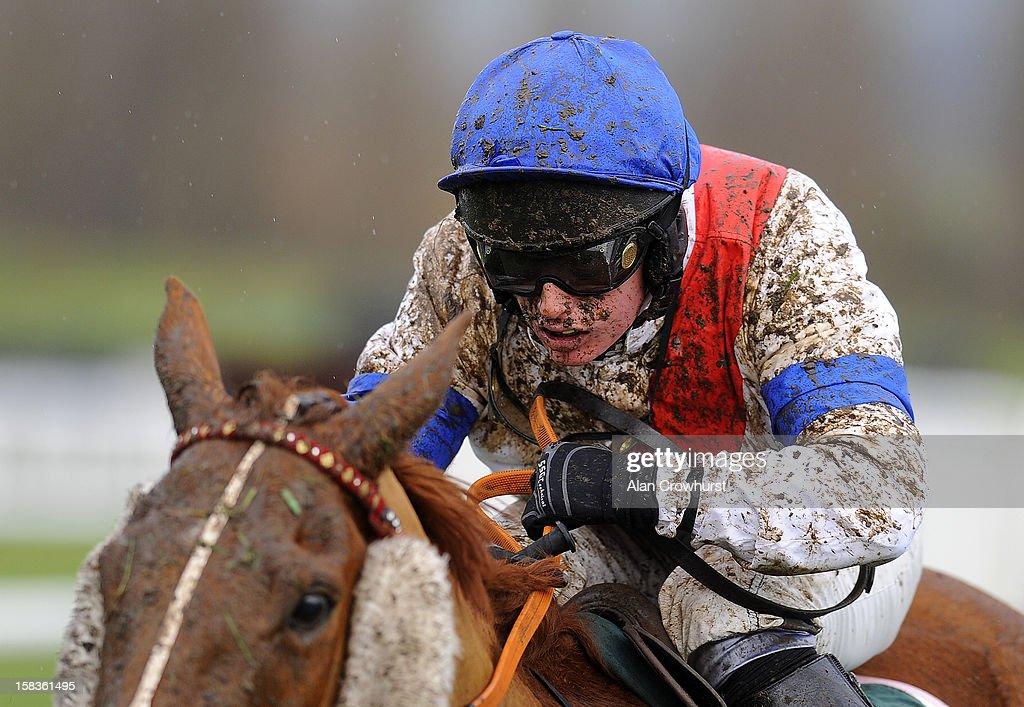A muddy Ryan Mahon in action at Cheltenham racecourse on December 14, 2012 in Cheltenham, England.
