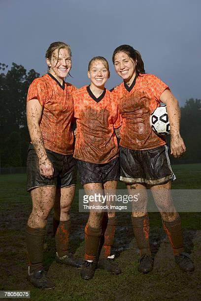 Muddy soccer players