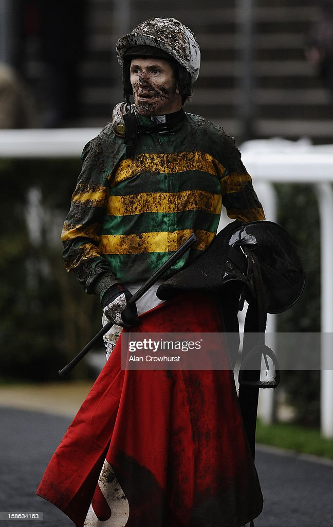A muddy Tony McCoy poses at Ascot racecourse on December 22, 2012 in Ascot, England.