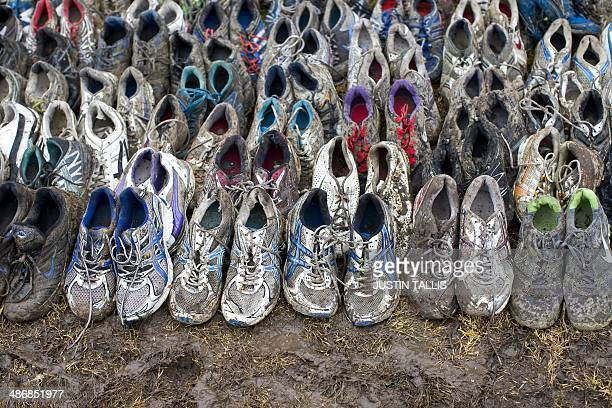 Muddy trainers are pictured at the end of the Tough Mudder endurance race in Henley on Thames West of London on April 26 2014 The course is set out...