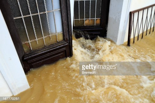 Muddy water pouring through the entrance door