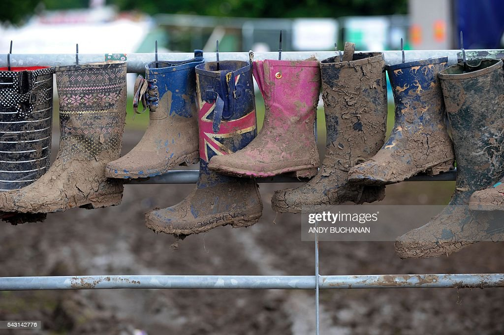 Muddy wellies hang up to dry on day five of the Glastonbury Festival of Music and Performing Arts on Worthy Farm near the village of Pilton in Somerset, South West England on June 26, 2016. / AFP / Andy Buchanan