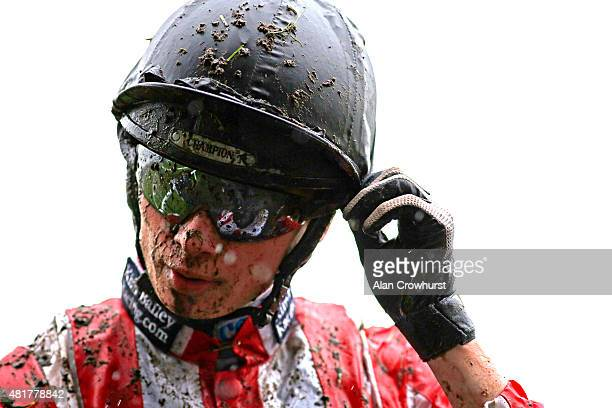 A muddy William TwistonDavies at Ascot racecourse on July 24 2015 in Ascot England