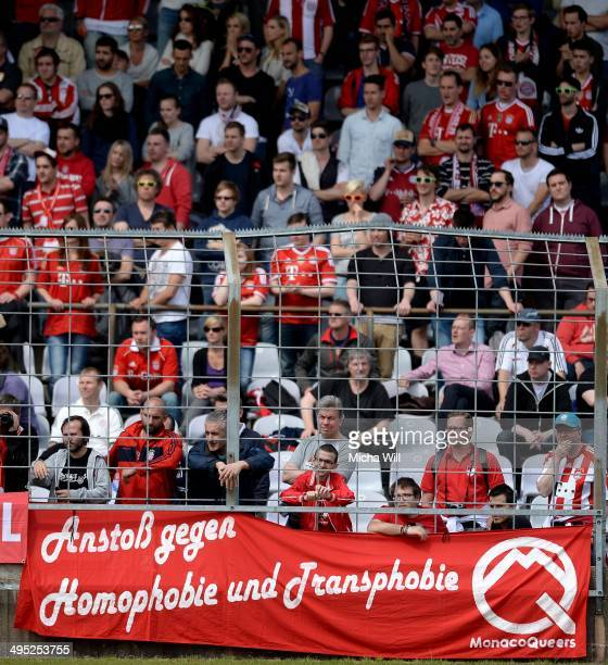 Muenchen fans show a banner against homophobia and transphobia during the second relegation leg between Bayern Muenchen II and Fortuna Koeln at...