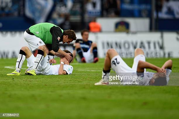 Muenchen players celebrate after their victory in the Second Bundesliga match between FSV Frankfurt and 1860 Muenchen at Volksbank Stadion on May 8...