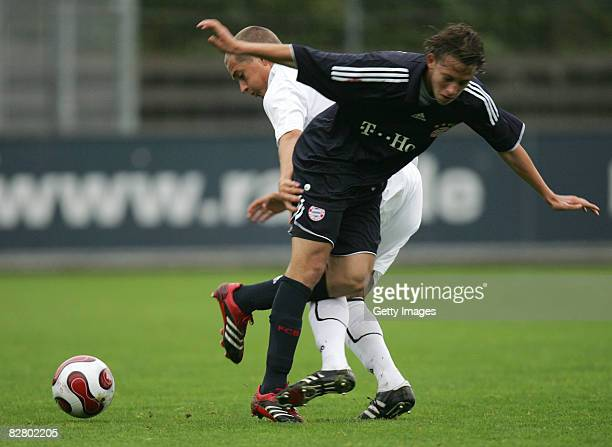 Muenchens B Pizarro and Freiburgs Niclas Ginter fight for the ball during the A Junioren Bundesliga match SC Freiburg and Bayern Muenchen at the...