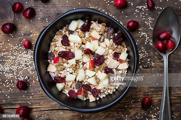 Muesli with puffed quinoa, wholemeal oatmeal, raisins, dried cranberries and apple