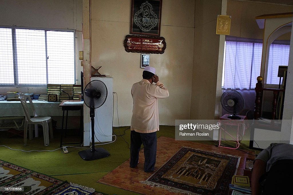 Muezzin performs a call to prayer at a small mosque in Kampung Air on November 7, 2013 in Bandar Seri Begawan, Brunei Darussalam. Sultan Hassanal Bolkiah has announced the introduction of a new Sharia penal code to be applied only to Muslims in the East Asian country. The Sultan of Brunei said the phasing in of the new code would begin in six months with reports that punishments could include stoning for offences such as adultery.