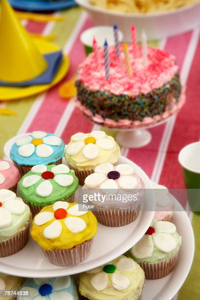 Muffins and Birthday Cake on Table