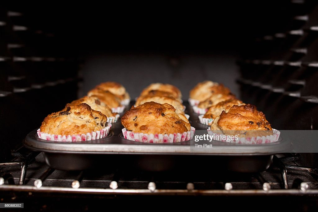 Muffins baking in an oven.