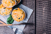 Muffins with Spinach and Cheese on Wooden Table Background. Healthy Breakfast Food Concept. Copy Space