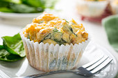 Muffins with spinach, sweet potatoes and cheese on white background. Healthy food concept.