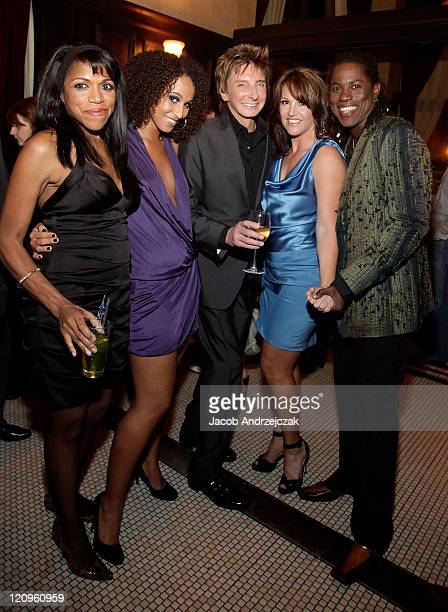 Muffy Hendrix Melanie Nyema singersongwriter Barry Manilow Keely Vasquez and Kye Brackett pose at Mon Ami Gabi French Bistro at the Paris Las Vegas...