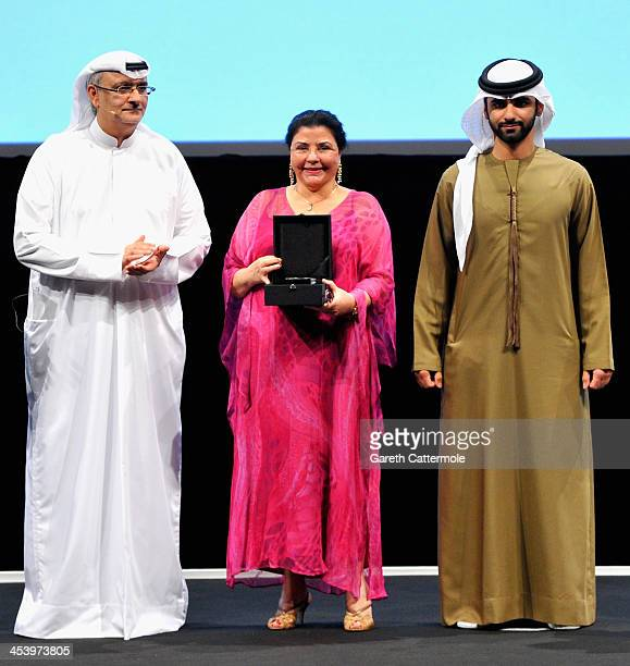 Mufida Tlatli with her award presented by HH Sheikh Mansoor bin Mohammed bin Rashid Al Maktoum and Artistic Director of DIFF Masoud Amralla Al Ali on...