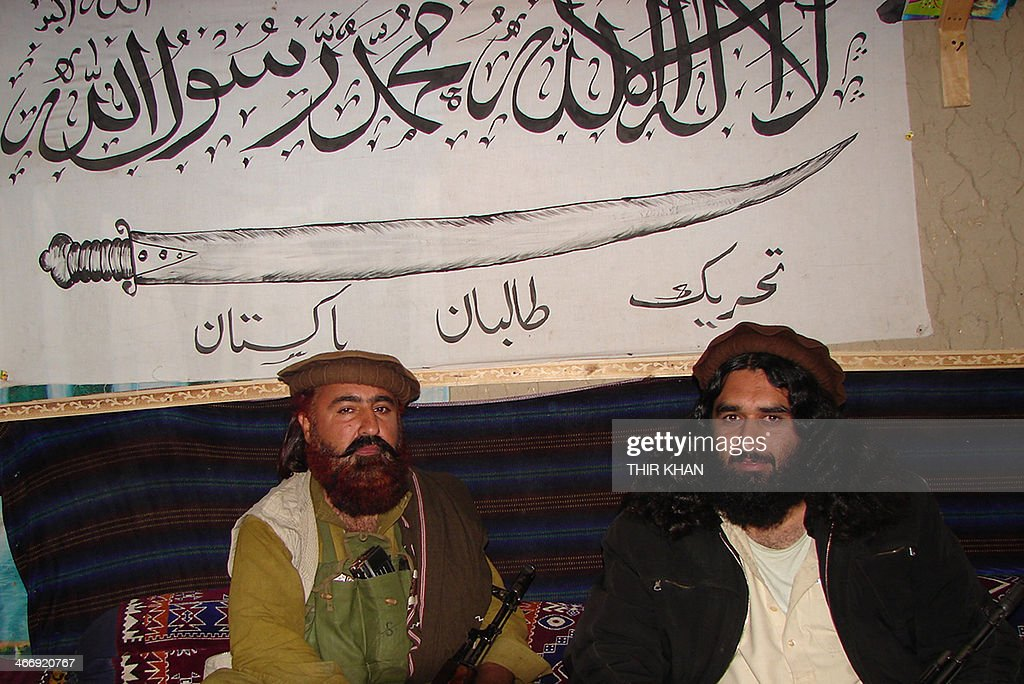 Mufti Hassan Swati the local commandor of Peshawar of TehreekeTaliban Pakistan sits with commandor major Mast Gul Mangel as he talks with AFP in the...