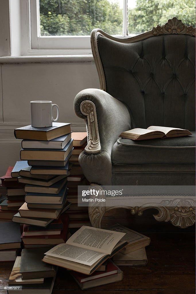 mug and pile of books  : Stock Photo