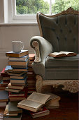 mug and pile of books