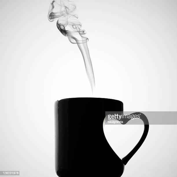 Mug of coffee with handle of heart shape