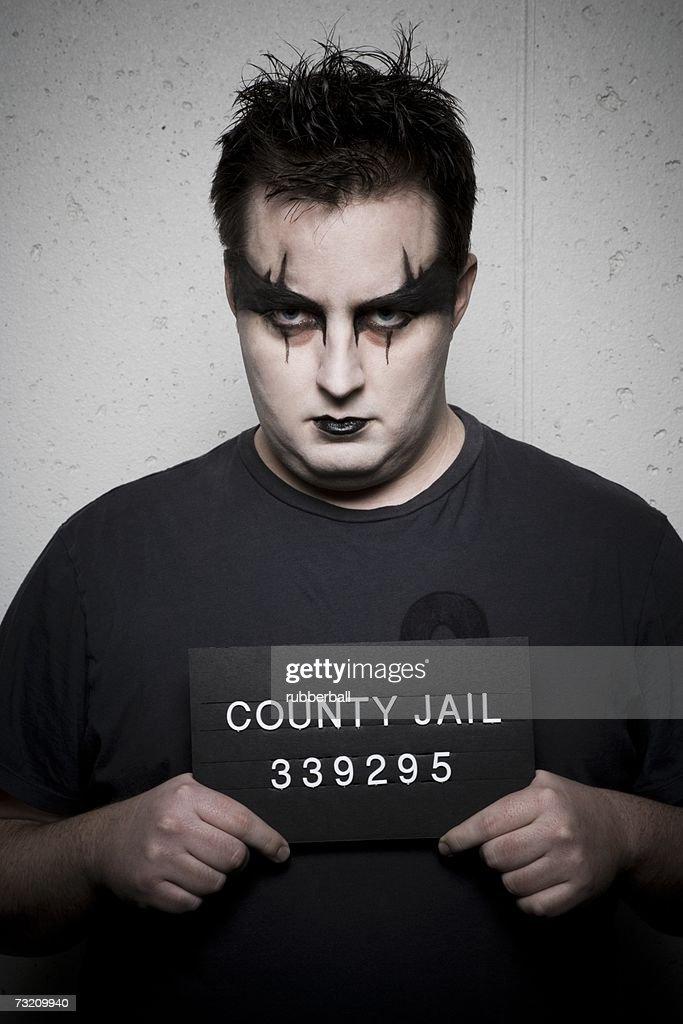 Mug shot of gothic man