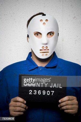 Mug shot of man with hockey mask