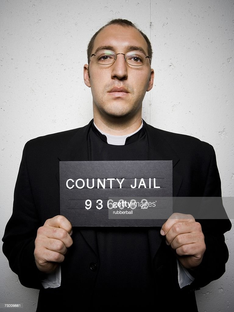 Mug shot of priest with glasses