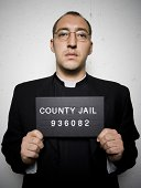 Mug shot of priest with glasses