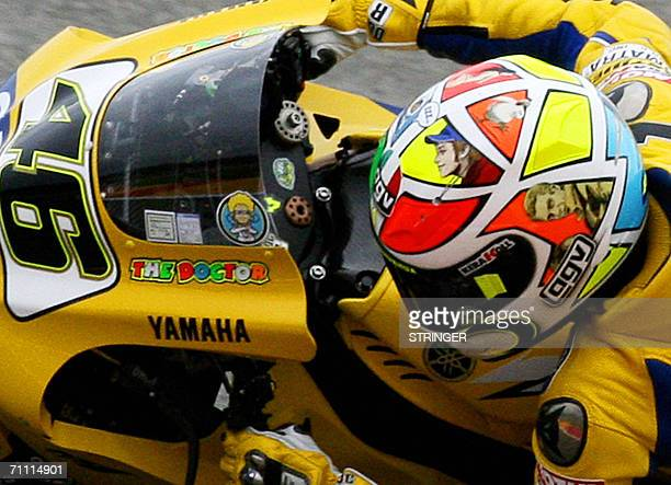 Moto GP Yamaha rider Italy's Valentino Rossi rides during the qualifying practice session of the Italian MotoGP Grand Prix at Mugello's racetrack 03...