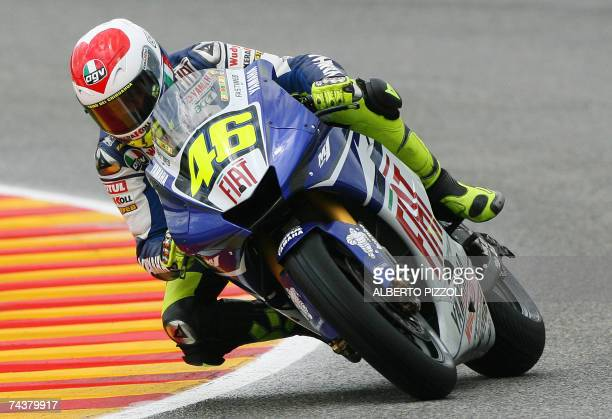 seventime world champion Italian Valentino Rossi of the Fiat Yamaha team rides during the qualifying rounds of the Italian MotoGP Grand Prix at...