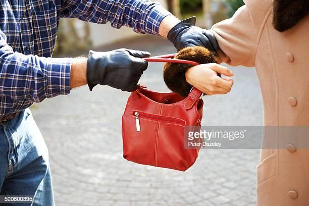 Mugger stealing handbag