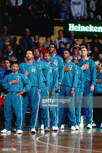 Muggsy Bogues Dell Curry Larry Johnson Hersey Hawkins Robert Parish Scott Burrell Greg Sutton and Joe Wolf of the Charlotte Hornets stand for the...
