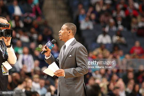 Muggsy Bogues former Charlotte Hornet speaks during the game between Charlotte Bobcats and the Chicago Bulls at the Time Warner Cable Arena on...