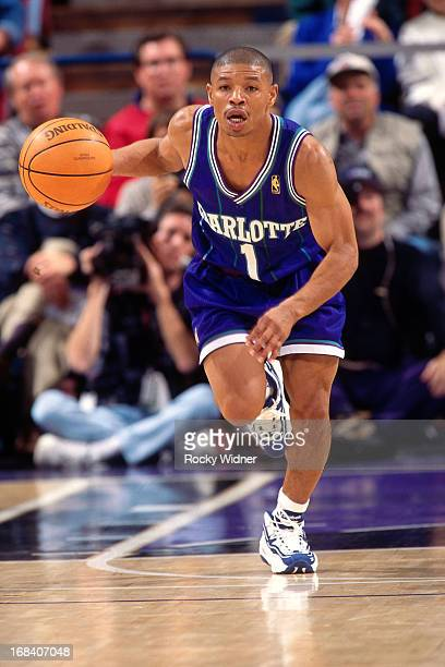 Muggsy Bogues of the Charlotte Hornets dribbles the ball against the Sacramento Kings during a game played on January 12 1997 at Arco Arena in...