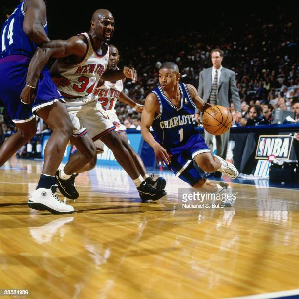 Muggsy Bogues of the Charlotte Hornets drives to the basket against Charles Oakley of the New York Knicks in Game One of the Eastern Conference...